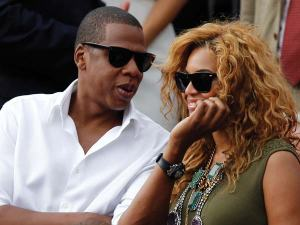 Jay-Z (left) had an unfortunate incident with his sister-in-law. He never threw a punch at her. Film don't lie. Right, Beyonce?