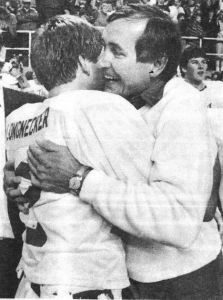 Jeremiah Longnecker and Pat Mitchell with a celebratory hug after the Tigers' 15-14 win over Linn-Mar to win the 1986 Class 4A state title. (Courier archives)